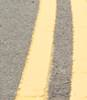 Nine inch double yellow lines painted on London street image